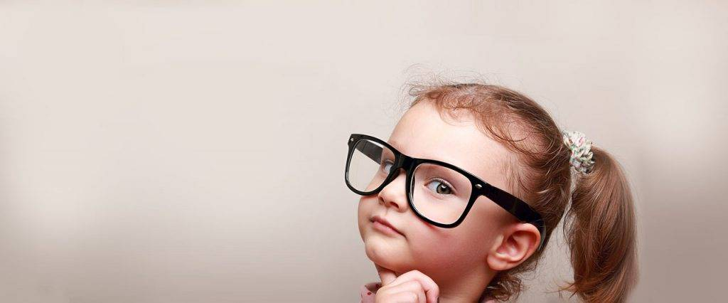 Child with glasses thinking